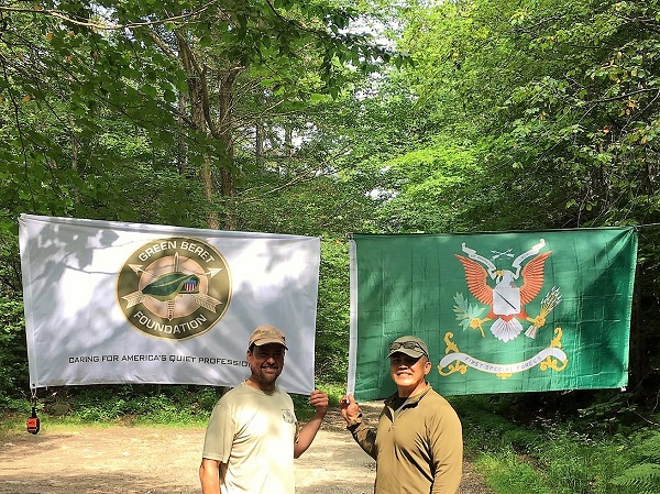 Ling Wong on Appalachian Trail with Special Forces Regimental Flag